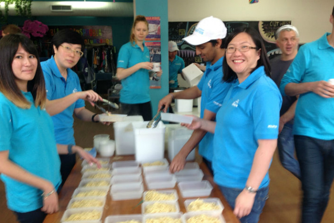 Corporate volunteers prepare meals for homeless LGBTIQA youth on Community Day of Action at Twenty10 inc. GLCS NSW in Sydney.