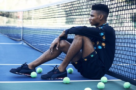 Supermodel Tajae Smith in black superfine cotton shirt and twill summer boy shorts with paint splatter detail inspired by Soldanza. Shoes: Puma Location: The Jamaica Pegasus HotelPhotographer: Wade Rhoden