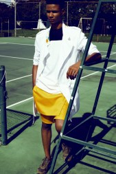 White trench with Soldanza inspired paint splatter details with black and white super fine cotton tunic and yellow cotton twill jumper shorts.Shoes: PumaPhotographer: Wade Rhoden