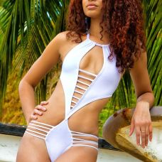 Rhion Romany - Trinidad & Tobago Showing the world what sexy means, Rhion Romany's swimsuits are eye-catching and barely there. His designs are for the more risky, fearless woman who loves to flaunt her figure. Photo Courtesy of Ted Mebane via Rhion Romany/Facebook