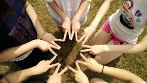 how to make friends - friends in a circle with their hands inwards