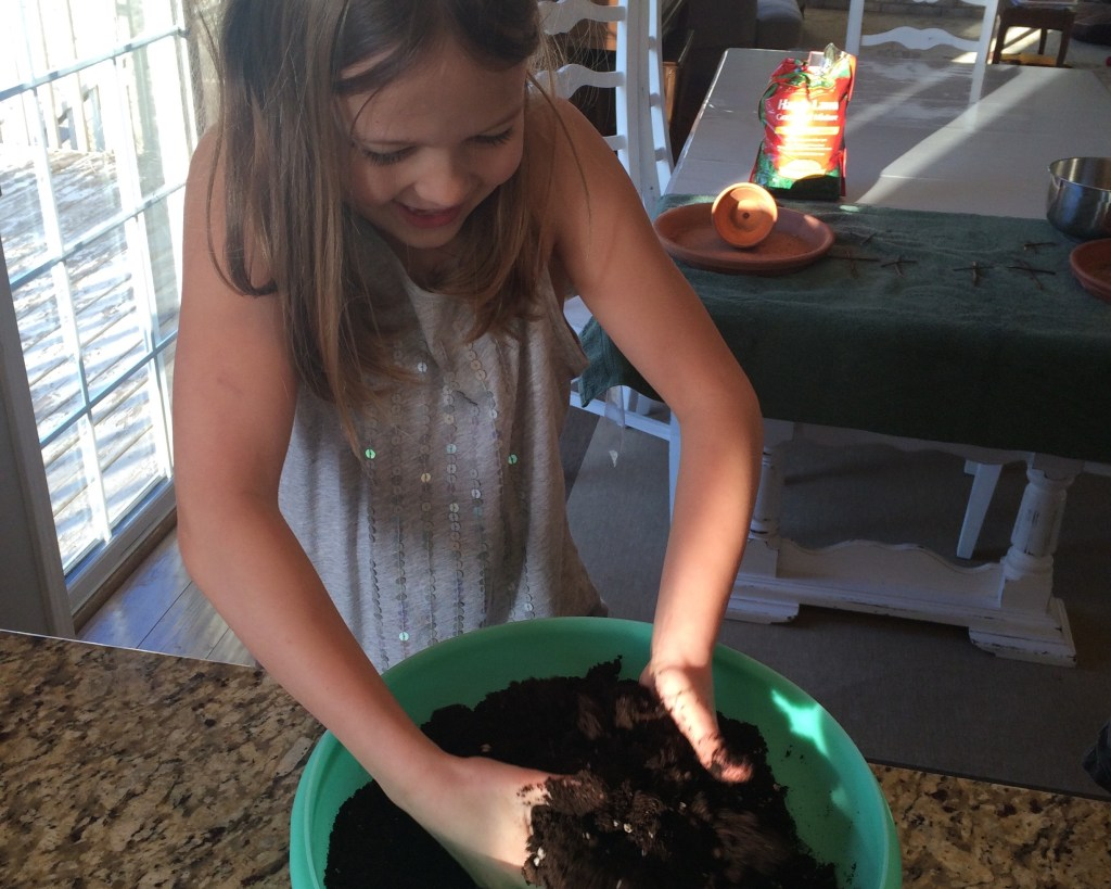 mixing soil and water for the Easter Garden