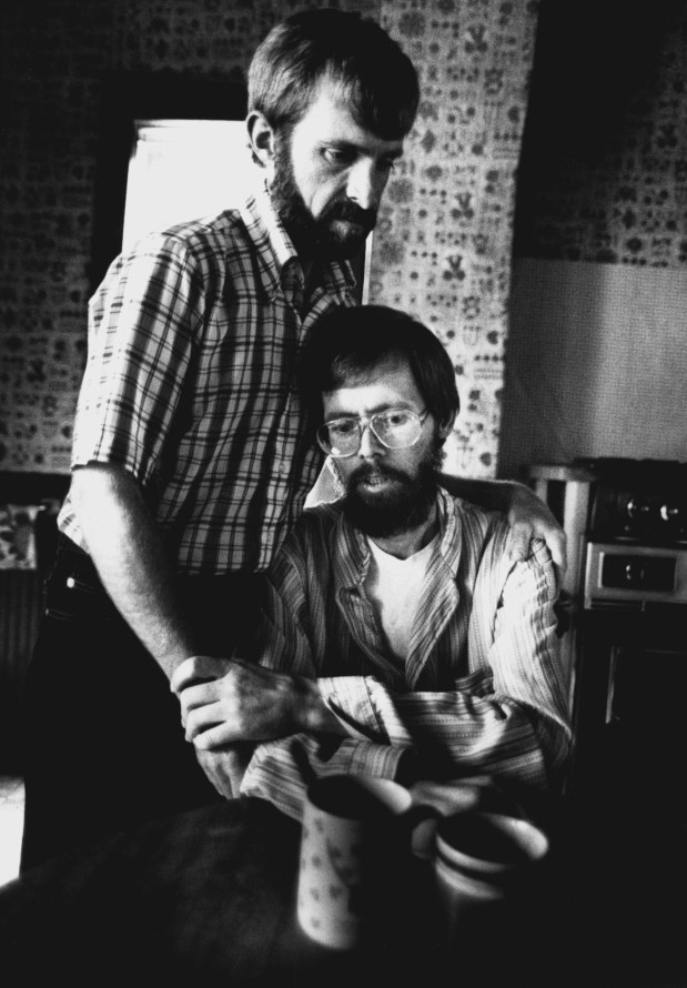 Bert Henningson and Dick Hanson reach for each other in a comforting embrace as they discuss funeral arrangements in their kitchen. (Pioneer Press: Jean Pieri)