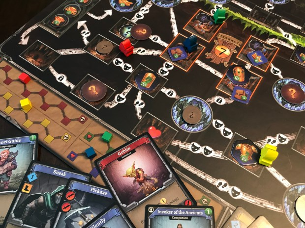 In Clank, you are collecting noisy treasure in a dungeon with a sleeping dragon.