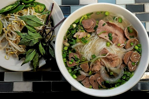 Pho tai bo vien with a garnish of Thai basil, bean sprouts, jalapeno and lime is served at iPho by Saigon. (Pioneer Press: Jean Pieri)