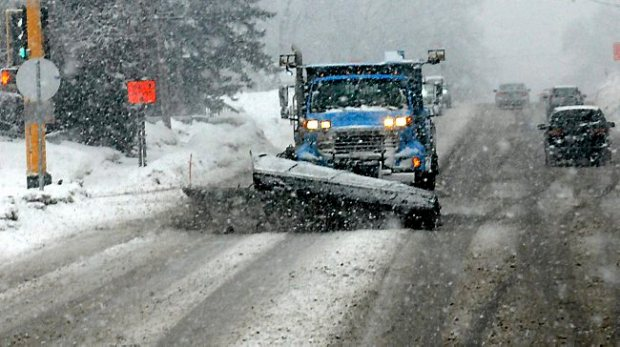 A St. Paul snow plow is on the road, Larpentuer Avenue to be exact, just west of Rice Street at about 2:30. Heavy wet snow began falling in the area at about 2 PM making for slow traffic during near white out conditions Thursday afternoon February 20, 2014. (Pioneer Press: John Doman)