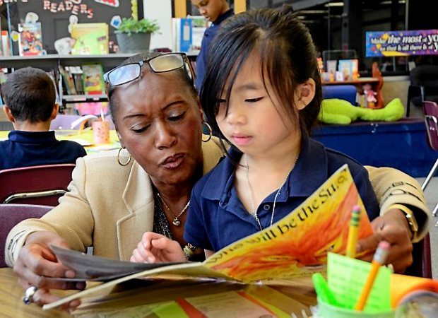 Principal Delores Henderson works with third-grader Windy Xiong on Thursday, Oct. 30, 2014, at Hazel Park Preparatory Academy in St. Paul. (Pioneer Press: Juan Pablo Ramirez)