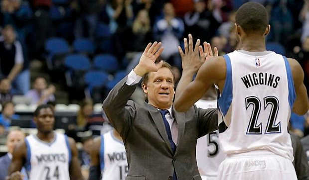 Timberwolves coach Flip Saunders congratulates forward Andrew Wiggins (22) after the Wolves beat the Portland Trail Blazers 90-82 on Dec. 10, 2014. (AP Photo/Ann Heisenfelt)