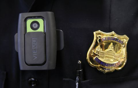 In this Jan. 22, 2015 photo, a body camera used by Des Moines Police Department school resource officers is worn by Sgt. Jason Halifax in Des Moines, Iowa. The rush by cities to outfit police officers with body cameras after last summer?s riots in Ferguson, Mo., is saddling local governments with steep costs for managing the volumes of footage they must keep for months or even years, according to contracts, invoices and company data reviewed by The Associated Press. (AP Photo/Charlie Neibergall)