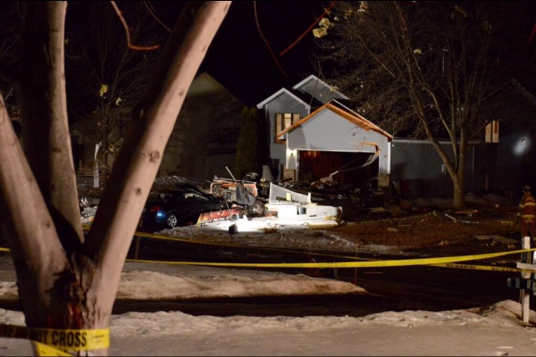The wreckage of a food truck is strewn about the yard of a Joplin Path home after an explosion Friday night, March 6, 2015, in Lakeville. (Courtesy photo)