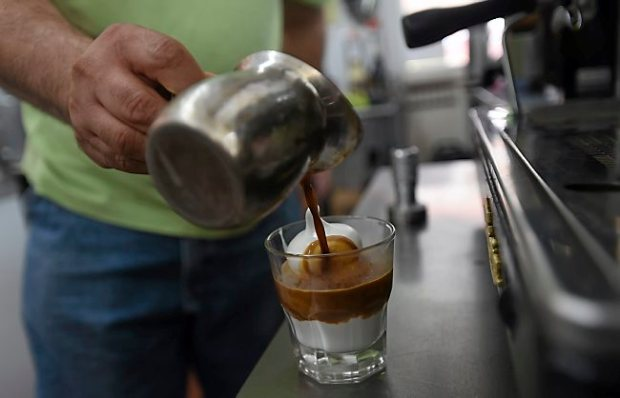 Icy Cup owner Pompeyo Sanchez makes an Affo Gato, which is two shots of espresso and soft-serve ice cream at his shop in St. Paul on Tuesday, June 30, 2015. (Pioneer Press: Holly Peterson)