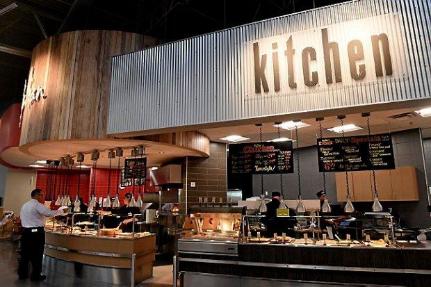 An employee orders food at Hy-Vee supermarket in Oakdale on Wednesday, September 16, 2015. The store is opening September 22. (Pioneer Press: Jean Pieri)