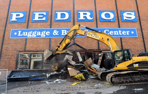 Demolition of the Pedro's Luggage building in downtown St. Paul, site of a future park, begins March 18, 2011. (Chris Polydoroff / Pioneer Press)
