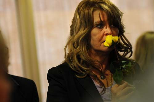 Trevor Robinson's mom, Jill Robinson, St. Paul, holds and smells a yellow rose as she talks to people after Trevor's service. Family and friends of Trevor Robinson, the 19-year-old who died last week after overdosing on a synthetic party drug, attend a visitation at North Heights Lutheran Church, Arden Hills, March 24, 2011. (Pioneer Press: Jean Pieri)