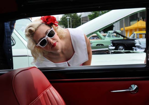 "Minneapolis Monique Rondeau checks out one of the 11,000 or so cars that are part of the MSRA ""Back to the 50's"" Weekend at the State Fair Friday morning June 19, 2009. It's the 36th annual gathering of the car enthusiasts and is one of the largest car shows in the nation. (Pioneer Press: Chris Polydoroff)"