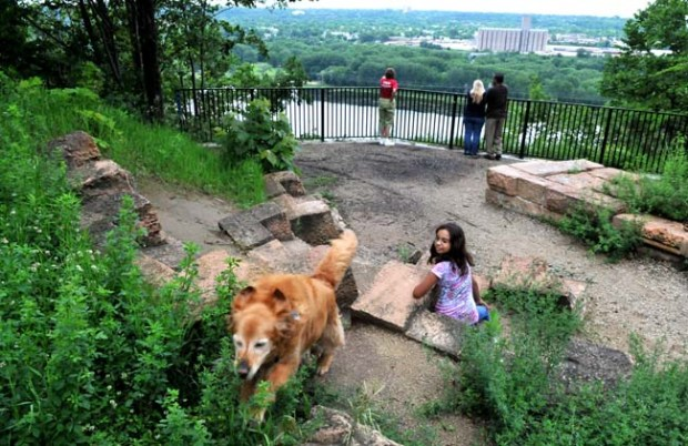 Halle Brower, 9, keeps track of Day-Z as the dog scampers among the stone seats at Bruce Vento's View, which overlooks Pickerel Lake.