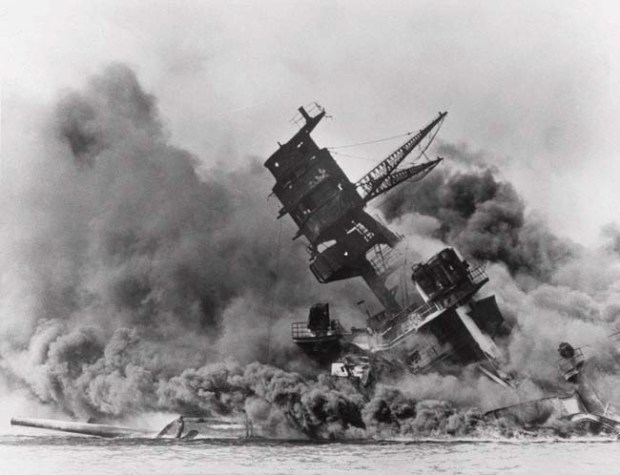 The USS Arizona sinks into Pearl Harbor after Japan's Dec. 7, 1941, surprise attack on the U.S. naval base in Hawaii. Some 1,177 officers and crewmen perished aboard the battleship when it exploded and sank after being bombed by Japanese warplanes.