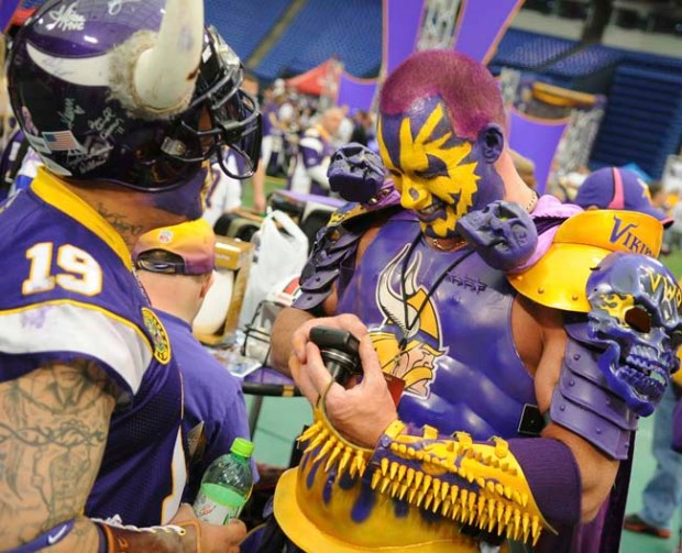 Karl Heinrichs, aka Sir Death, right, checks out some photos on a camera along with Diggz Garza during the Vikings Draft Party Friday night, April 26, 2012, at the Metrodome in Minneapolis. Heinrichs drives in from Grand Forks, ND, for every Vikings game and the draft party. (Pioneer Press: John Autey)
