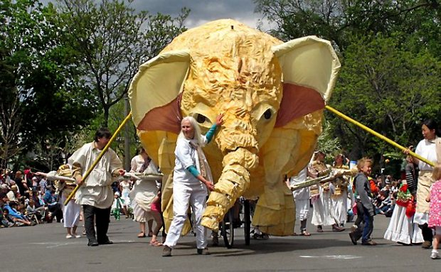 Gangway! Elephant coming through! Must be the annual MayDay Parade. (Pioneer Press: Ben Garvin)