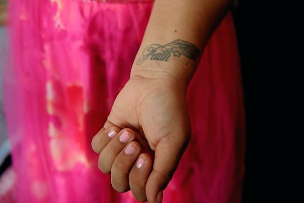 "Gladys Reyes shows her tattoo, ""Faith,"" on her arm, Friday, May 3, 2013. She said her brother has a tattoo, ""Hope,"" on his arm. (Pioneer Press: Jean Pieri)"