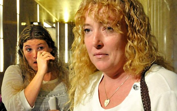 Anna Hurd's aunt Penny Griffin wipes away a tear as her sister, mom Jennifer Hutchings, talks to the press after the decisions were rendered and Anthony Mitchell was sentenced at the Ramsey Co. Courthouse in St Paul Tuesday afternoon June 25, 2013. (Pioneer Press: John Doman)