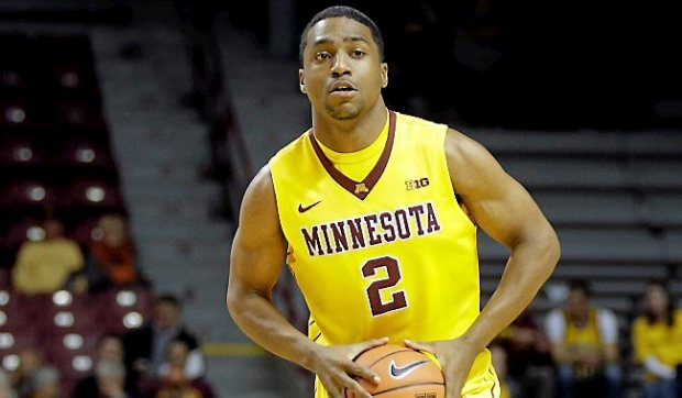 Minnesota's Kendal Shell looks to pass the ball in the second half of an NCAA college basketball game against Montana, Tuesday, Nov. 12, 2013 in Minneapolis. (AP Photo/Jim Mone)