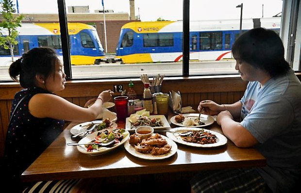 Mai Yang, left, eats lunch with her husband Xai Vang, both of St. Paul, at Bangkok Thai Deli on University Avenue in St. Paul on Wednesday, June 4, 2014. (Pioneer Press: Ben Garvin)