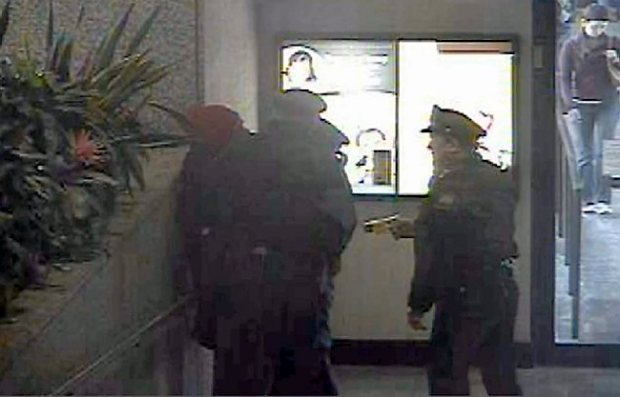 "A still image from a skyway surveillance video released Wednesday, Sept. 10, 2014 by St. Paul police related to the controversial arrest of Chris Lollie earlier this year. Lollie, 28, of St. Paul, recorded his encounter with police officers Jan. 31, 2014 and posted the cellphone video to YouTube on Aug. 26. The video, which Lollie titled ""Black man taken to jail for sitting in public area,"" has been viewed more than 1.2 million times. The video goes dark after about 2 minutes, when Lollie said an officer put his cellphone on a ledge, but the audio continued. Police had obtained the skyway surveillance videos for their criminal investigation after Lollie's arrest, and they released the videos in response to media requests. One is from the First National Bank Building before police were called; the other is from the Securian Center when an officer Tased Lollie. Neither system records audio."
