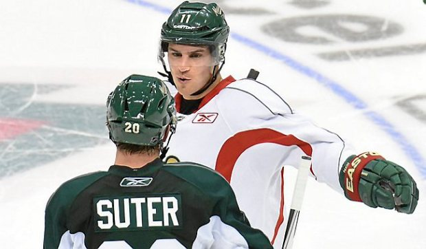 Minnesota Wild's Zach Parise, right, and Ryan Suter chat at the Minnesota Wild training camp on Sept. 18, 2015, at Xcel Energy Center in St. Paul. (Pioneer Press: Jean Pieri)