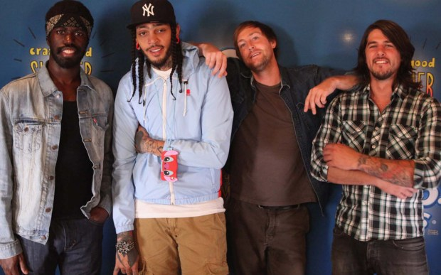 Drummer Matt McGinley, second from right, of rap-rockers Gym Class Heroes is 33. From left are bandmates Disashi Lumumba-Kasongo, Travie McCoy, McGinley and Eric Roberts. (Getty Images: Jeff Schear)
