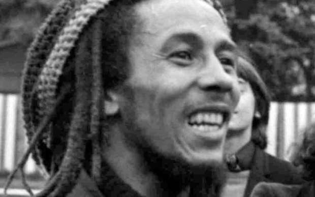 """The late reggae legend Bob Marley was born on this day in 1945. The singer of """"Redemption Song,"""" """"No Woman No Cry"""" and """"One Love"""" died of cancer in 1981. He's shown talking to reporters before a practice match with friends and musicians at a soccer field in Paris, France, on May 10, 1977. (Associated Press file photo)"""