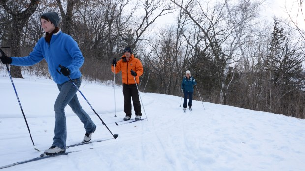 """AFTON STATE PARK. Here, 15 miles of classic cross country ski trails run along the Afton bluffs of the St. Croix River Valley. Trails are rated from """"easy"""" to """"most difficult"""" and take skiers alongside the western side of the river and into the hills, woods and prairie above. There is no ski rental available and parking requires a Minnesota State Park parking permit. Visitors 16 and older will also need a """"Great Minnesota Ski Pass"""" ($6 daily; $20 season). (Photo courtesy of the Minnesota Department of Natural Resources)"""