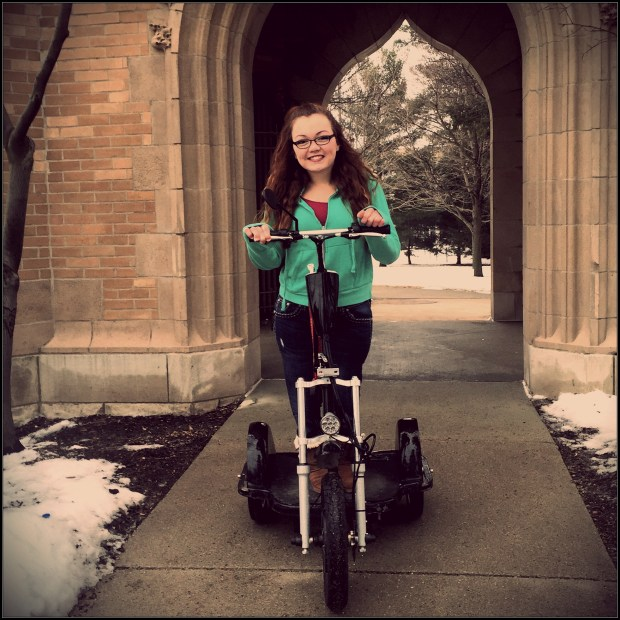 After being bullied for using an electric vehicle to get around campus, Iowa State University freshman and Gillette Children's Specialty Healthcare patient Brittni Wendling, 18, wrote an open letter to the Internet about the importance of never making assumptions and always being kind. (Photo by Megan Kemp)
