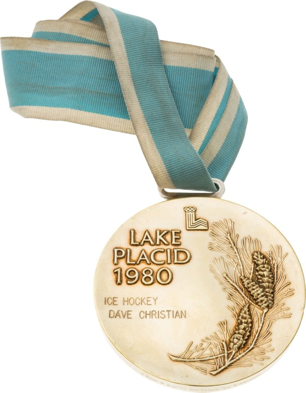 This handout provided by Heritage Auctions shows the 1980 Olympic Gold medal presented to U.S. hockey player Dave Christian. Father and son Bill Christian and Dave Christian have put their Olympic gold medals, among many other items, up for auction this month. The memorabilia is valuable, but the memories can't be bought or sold. (Brian Fewell/Heritage Auctions via AP)