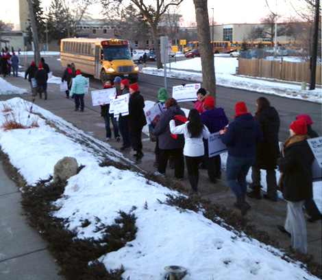 Como Park Senior High School teachers, staff and supporters demonstrate outside the school Wednesday morning to call attention to their dissatisfaction with contract negotiations. (Courtesy photo)