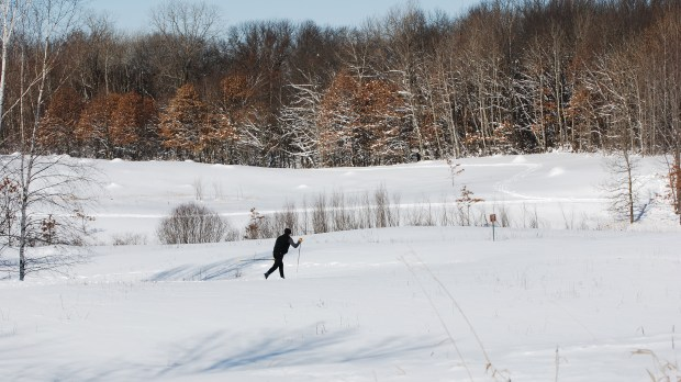 """LEBANON HILLS REGIONAL PARK. The main portion of this 2,000-acre Eagan park features 14.6 miles of classic and skate skiing trails around a network of small lakes. There's also the western section of the park, which features 2.4 miles of ski skating trails and 3.2 miles of classic skating trails. A Dakota County """"Cross-Country Ski Pass"""" is required for all skiers ages 18 and older on the county's ski trails ($5 daily; $20 season). Equipment rental is available at the park's visitor center, 860 Cliff Road. (Photo courtesy of Dakota County Parks)"""