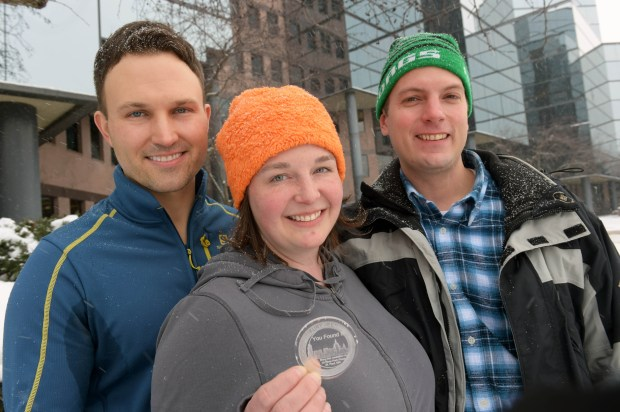 Pioneer Press Treasure Hunt winners, from left, Christopher Jozwiak, Heather Vocke and Phillip Kitzer, all of Minneapolis, show off their find outside the Pioneer Press headquarters on Thursday, Feb. 4, 2016. (Pioneer Press: Scott Takushi)