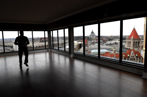 Listing agent Goran Zejzovic shows off the second-floor entertainment room of a condo in the Lowry Building. The two-story penthouse is the most expensive condo downtown, based on estimated market value. (Pioneer Press: Jean Pieri)
