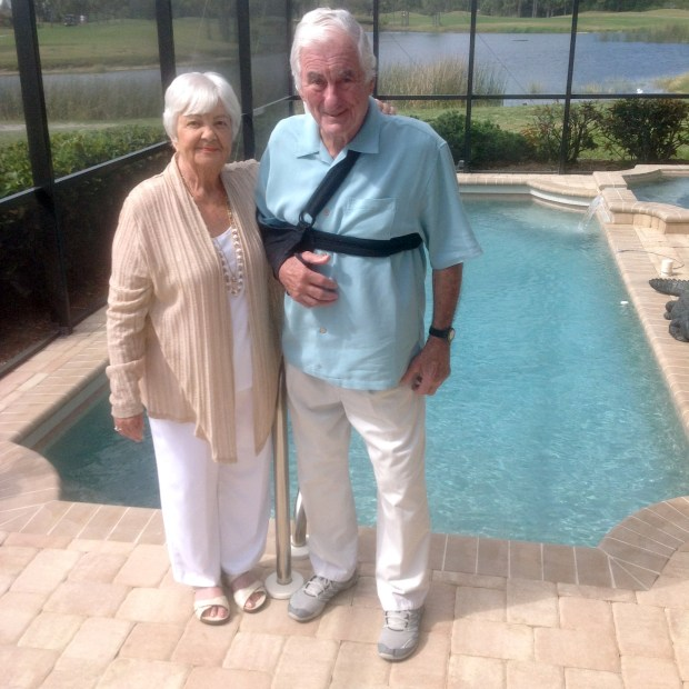 Phyllis and Al Hohenwald, the owners of Spartan Promotional Group in Oakdale, pose Tuesday in the back yard of their house in Venice, Fla. The company is celebrating its 50th anniversary on Tuesday at the Prom Center in Oakdale. The Hohenwalds will be unable to attend as Al Hohenwald is recovering from a recent shoulder surgery, but will appear via video feed. (Courtesy of Spartan Promotional Group)