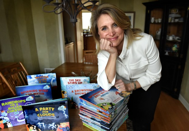 KARE-TV meterologist Belinda Jensen with her books Friday, March 4, 2016, in Edina. (Pioneer Press: Jean Pieri)