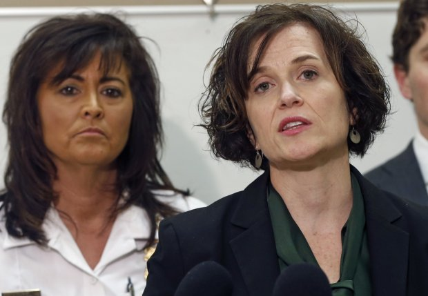 Minneapolis Police Chief Janee Harteau, left, listens as Mayor Betsy Hodges addresses a news conference Wednesday, March 30, 2016 following County Attorney Mike Freeman's announcement that no charges will be filed against two Minneapolis police officers in the fatal shooting of a black man, Jamar Clark, last November. (AP Photo/Jim Mone)