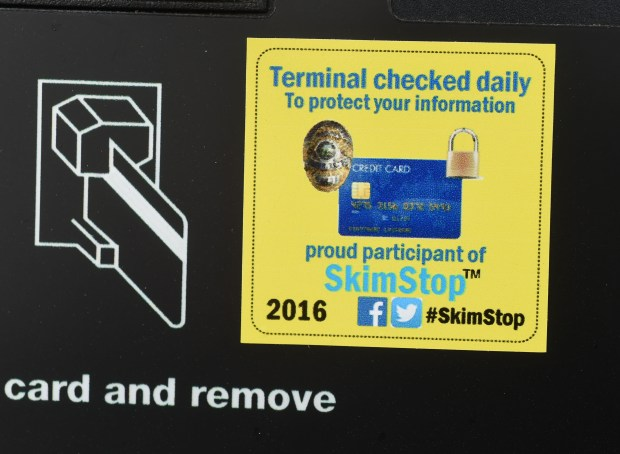 A gas pump at the New-Mart Marathon in Eagan bears this sticker. Store manager Matt Klinkhammer checks pumps every day to make sure thieves have not installed electronic skimmers in the card readers. (Pioneer Press: Scott Takushi)