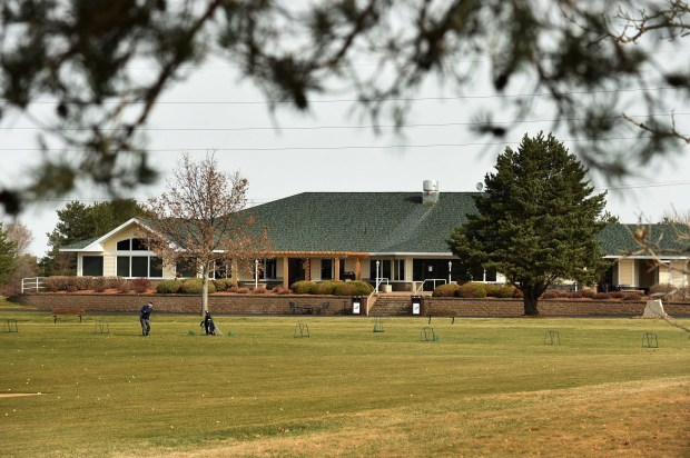 A golfer uses the driving range at the River Oaks Golf Course in Cottage Grove, on Tuesday, March 29, 2016. The clubhouse is in the background. Pioneer Press: Scott Takushi)