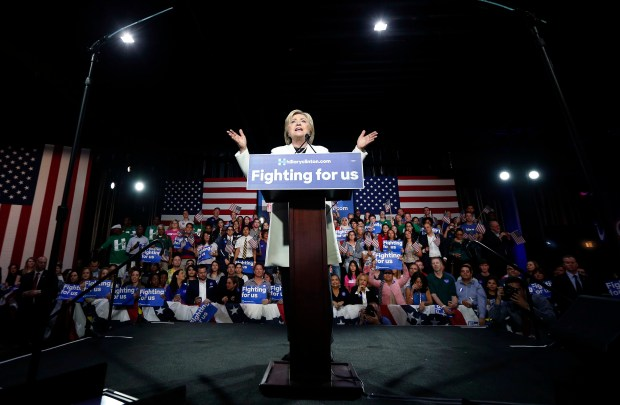 Democratic presidential candidate Hillary Clinton addresses supporters at her Super Tuesday election night rally in Miami, Tuesday, March 1, 2016. (AP Photo/Gerald Herbert)