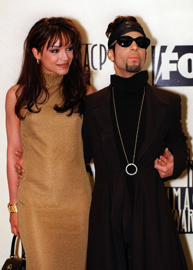 Prince poses backstage with his wife Mayte at the 28th annual NAACP Image Awards Feb. 8, 1997, in Pasadena, Calif. (AP Photo/Mark J. Terrill, File)