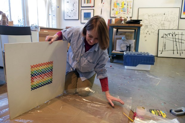 Sculptor and painter Caprice Glaser wraps prints in plastic before packing them away at her Jax Building studio in St. Paul's Lowertown, where she has been a tenant for 13 years, on March 1, 2016. The Lowertown arts community is being shaken up as long term renters and artists are being displaced. (Pioneer Press: Scott Takushi)