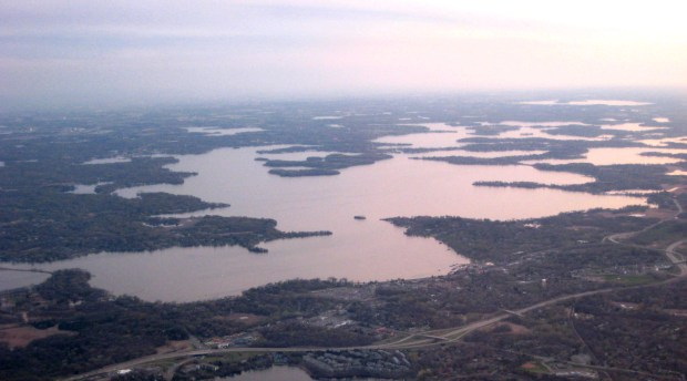 Lake Minnetonka in west suburban Minneapolis, Minn., is shown in an aerial photograph taken April 24, 2007. In April 2016 researchers studying invasive zebra mussels on the lake announced they had made several discoveries. The 23-square-mile lake consists of numerous basins of varying water quality and clarity, and zebra mussel success varied across different portions of the lake. Photo courtesy of Ed Kohler.