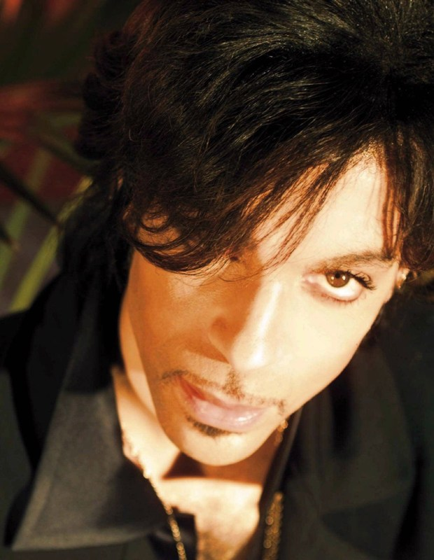 "Prince plans to perform his '80s megahit ""1999"" for the last time in a pay-per-view concert on New Year's Eve, he announced on December, 19, 1999. (AP Photo/Steven Parke, File)"