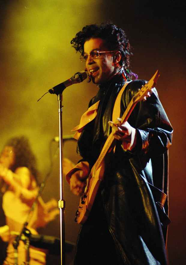 Prince performs on the stage of the Paris Bercy Stadium in front of thousands of fans, Sunday evening, June 14, 1987. (AP Photo/Olivier Boitet)