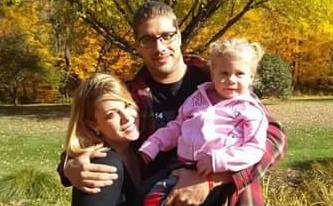 Nicholas Tousley, center, is pictured with his then girlfriend, Kathryn Sutton, and their daughter, Scarlette. (Courtesy photo)